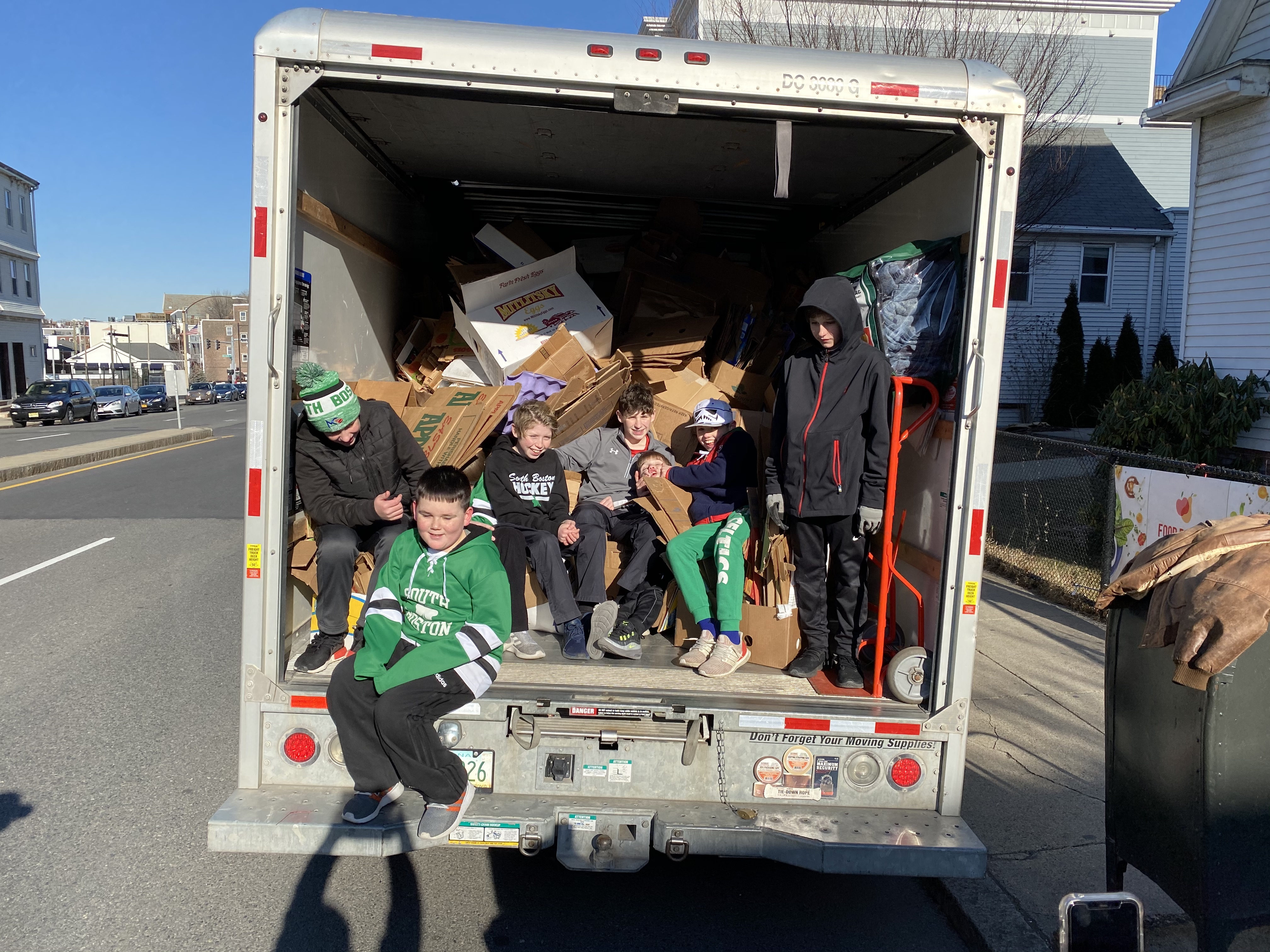 South Boston Youth Hockey Players Volunteer at the Food Pantry